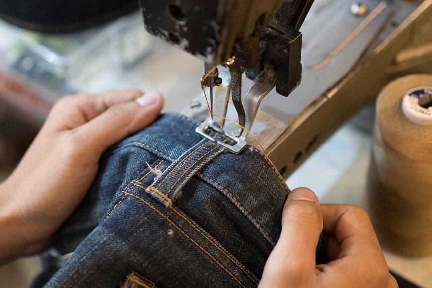 Tailors work on garment